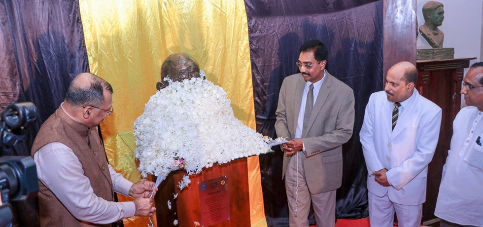 Gandhi @ 150 celebrations  -  Consul General & Mr. Hemal Gunasekara, Hon' Governor of Southern Province unveiling  Mahatma Gandhi's bust presented by the Consulate to Mahinda College, Galle
