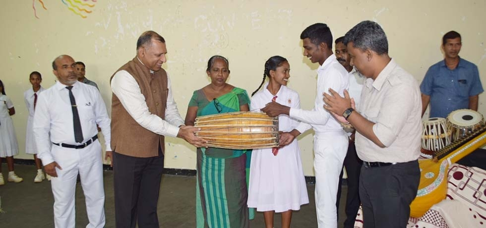 Consul General, Mr. Prem Nair handing over the Indian Musical Instruments to schools at Deniyaya on 28th February 2020