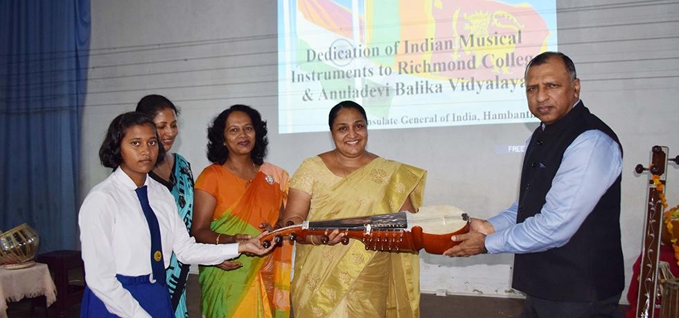 Consul General, Mr. Prem Nair handing over the Indian Musical Instruments to Principal of Anuladevi Balika Vidyalaya on 3rd March 2020